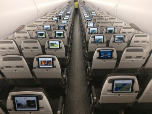 Photo of interior of Titan Airway's Airbus A321LR during test flight of Bluebox's wireless IFE integration with Airbus OSP