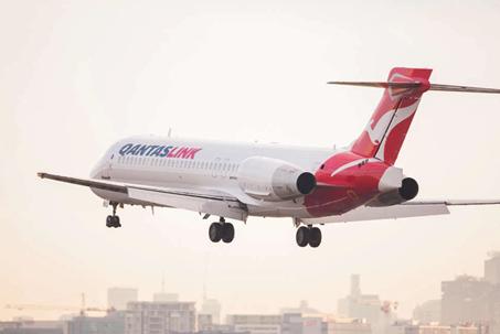 Photograph of QantasLink Boeing B717 aircraft flying